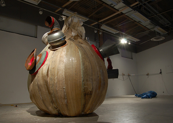 Bil'in Onion 2007 steel, fiberglass, found ventilation system, red duct tape, sound component approx 9' x 9' diameter