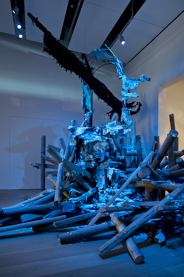 Boreal 2015 Installation view, The Esker Foundation, Calgary, AB steel, DOW chemical polystyrene fanfold, iridescent black feathers, paper mache, timber, black enamel, synthetic blue light dimensions variable