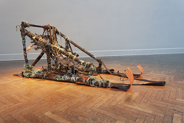 Dog Sled 2013 made of petroleum trash found on the shores of Arctic fijords, built while living and sailing on a Barquentine Tall Ship in the Arctic Circle. 4' x 5' x 7'